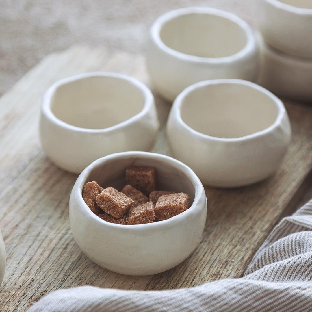 White handmade ceramic dish with brown sugar